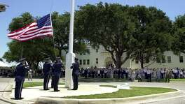 Kelly Air Force Base honor guard retires the base's American flag during closing ceremonies on Friday, July 13, 2001.