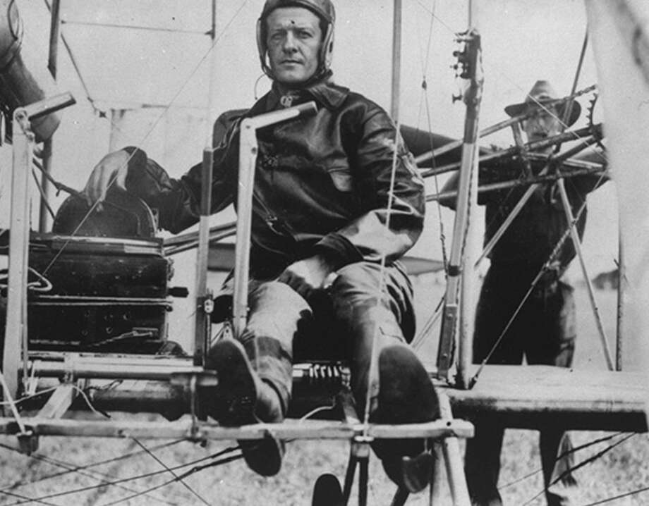 Maj. Benjamin Foulois, who made the first successful powered military flight in 1910 at Fort Sam Houston, sits in the cockpit of a Wright Flyer the following year. He selected a 677-acre tract of land on the city's South Side as the site for Kelly Field because it was far from civilization. Photo: Courtesy Air Education And Training Command / Air Education and Training Command history office