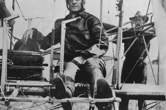 Maj. Benjamin Foulois, who made the first successful powered military flight in 1910 at Fort Sam Houston, sits in the cockpit of a Wright Flyer the following year. He selected a 677-acre tract of land on the city's South Side as the site for Kelly Field because it was far from civilization.