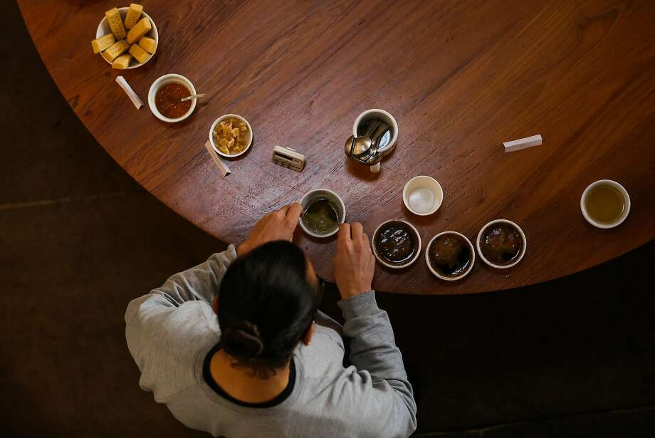Ritual employee Aaron Van Der Groen prepares for a coffee tasting at the Ritual Coffee roasting plant in San Francisco, Calif., on Tuesday, Jan. 17, 2017. Ritual will be partnering with cannabis company Somatik on the release of an 8-oz bottle of cold brewed coffee with 15 mg of THC in it which will hit the market next week. Photo: Gabrielle Lurie, The Chronicle