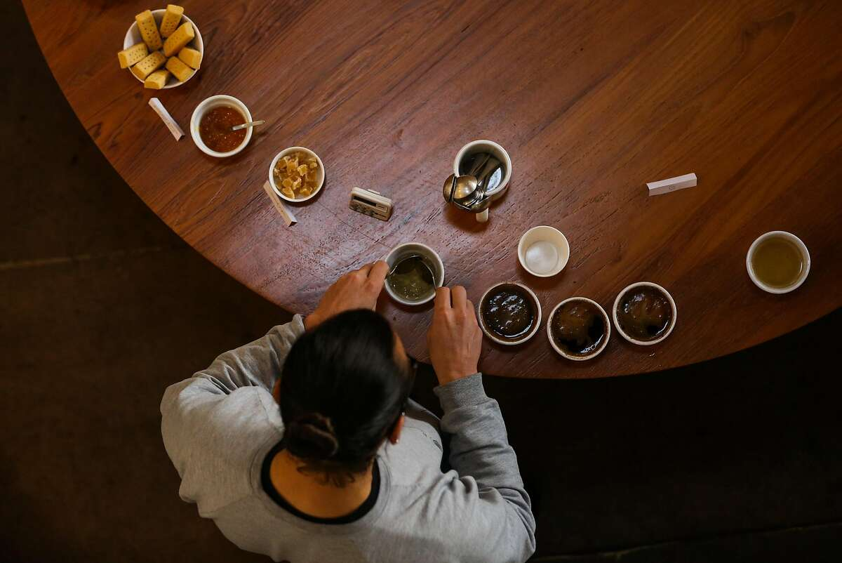 Ritual employee Aaron Van Der Groen prepares for a coffee tasting at the Ritual Coffee roasting plant in San Francisco, Calif., on Tuesday, Jan. 17, 2017. Ritual will be partnering with cannabis company Somatik on the release of an 8-oz bottle of cold brewed coffee with 15 mg of THC in it which will hit the market next week.