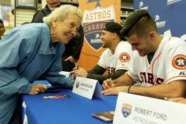 Margaret Anderson, left, shares a laugh with Houston Astros pitcher Lance McCullers during an autograph session at Academy Sports & Outdoors as part of the Astros' annual offseason caravan trip across Texas Wednesday, Jan. 18, 2017, in The Woodlands.