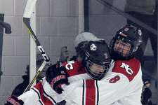 New Canaan Tyler Hilll celebrates his goal on Greenwich with Drew Morris in a FCIAC boys hockey game at the Darien Ice Rink in Darien, Conn. on Jan. 18, 2017. New Canaan defeated Greenwich 7-4.