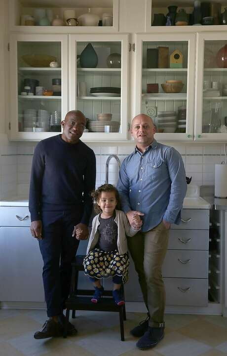 Designers Marcus Keller (left) and Robbie McMillan with their daughter, Apple, in their Potrero Hill kitchen. Photo: Liz Hafalia, The Chronicle