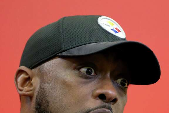 Pittsburgh Steelers head coach Mike Tomlin talks with reporters after their NFL football practice, Wednesday, Jan. 18, 2017, in Pittsburgh. The Steelers face the New England Patriots in the AFC conference championship on Sunday. (AP Photo/Keith Srakocic)