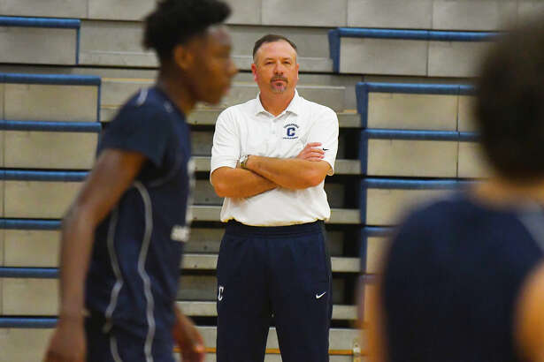 Concordia Lutheran Boys Basketball head coach Bill Honeck watches as the Crusaders run through drills at practice Wednesday. Honeck said that it was about 10 games into the season that he began to talk with his team, currently the top-ranked private squad in the state, about the possibility of winning a state title.