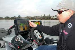 Professional bass tournament angler Keith Combs uses some of his boat's extensive marine electronics to help locate potential fishing areas while scouting Lake Conroe, site of the 2017 Bassmaster Classic in March.