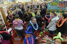 DENVER, CO - FEBRUARY 14: People crowd into the new Trader Joe's, located on Colorado Blvd. and East 8th Avenue in Denver, for the grand opening of specialty grocer, February, 14 2014. Two other Trader Joe's locations in Colorado will also open today. (Photo by RJ Sangosti/The Denver Post via Getty Images)
