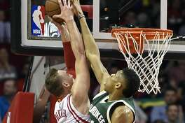 Houston Rockets forward Sam Dekker, left, attempts to dunk as Milwaukee Bucks forward Giannis Antetokounmpo defends during the first half of an NBA basketball game, Wednesday, Jan. 18, 2017, in Houston. (AP Photo/Eric Christian Smith)