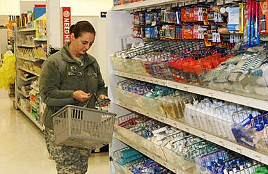 A soldier shopping at an Army post exchange at Fort McCoy, Wisc.