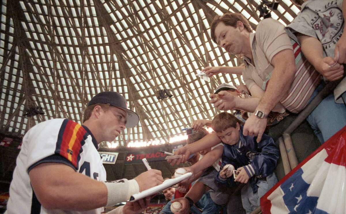 These fans at the Astrodome were among many who have received an autograph from Jeff Bagwell, who now can add the inscription