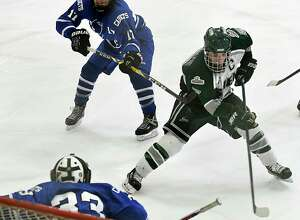 Shenendehowa's Hayden Haldane, right, gets the puck past La Salle goalie Zac Rentz to score late in the third period to give Shen a 5-3 lead during a hockey game at Clifton Park Arena on Wednesday, Jan. 18, 2017 in Albany, N.Y. (Lori Van Buren / Times Union)