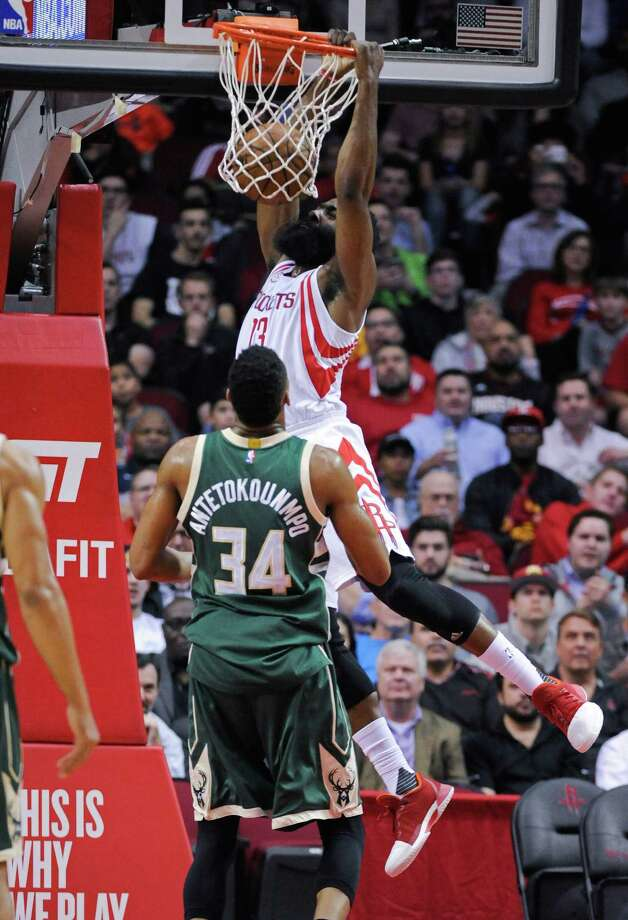 Houston Rockets guard James Harden (13) dunks as Milwaukee Bucks forward Giannis Antetokounmpo (34) looks on in the first half of an NBA basketball game, Wednesday, Jan. 18, 2017, in Houston. (AP Photo/Eric Christian Smith) Photo: Eric Christian Smith, FRE / FR171023 AP
