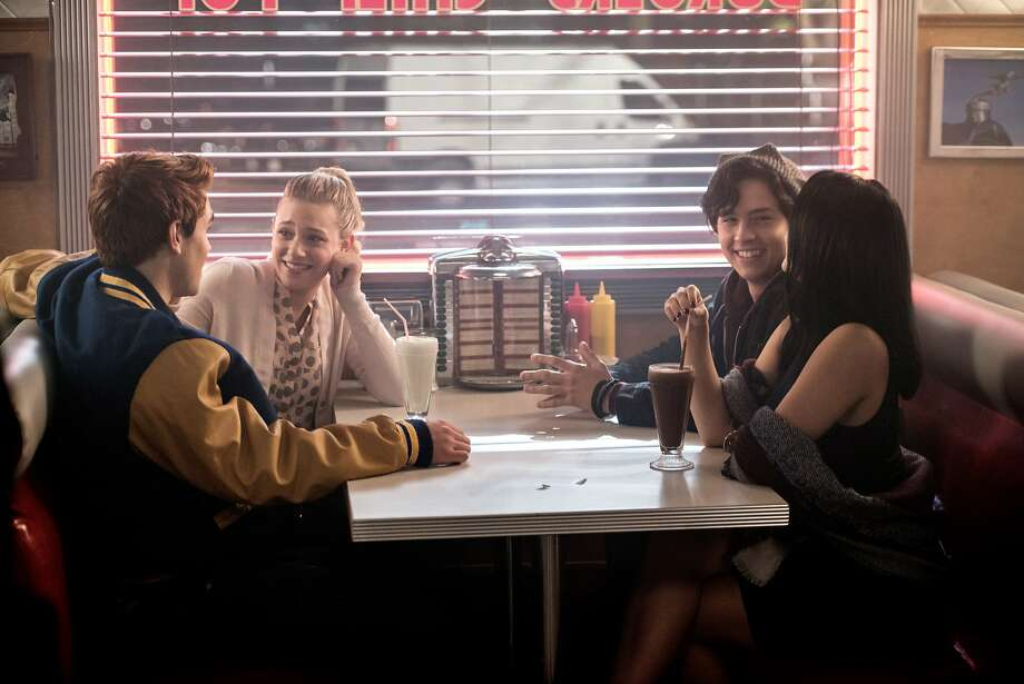 Pop's Chock'lit Shoppe is the setting of one of 'Riverdale's' happier moments. KJ Apa as Archie Andrews, Lili Reinhart as Betty Cooper, Cole Sprouse as Jughead Jones, and Camila Mendes as Veronica Lodge.  : Photo: Diyah Pera/The CW, The CW