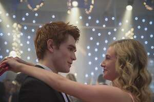 KJ Apa as Archie and Lili Reinhart as Betty in a happy moment at the Riverdale High dance.
