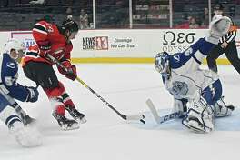 Albany Devils' Brian Gibbons, #14, takes a shot at the net but Syracuse Crunch goalie Adam Wilcox makes the save during a hockey game at the Times Union Center on Wednesday, Jan. 18, 2017 in Albany, N.Y. (Lori Van Buren / Times Union)