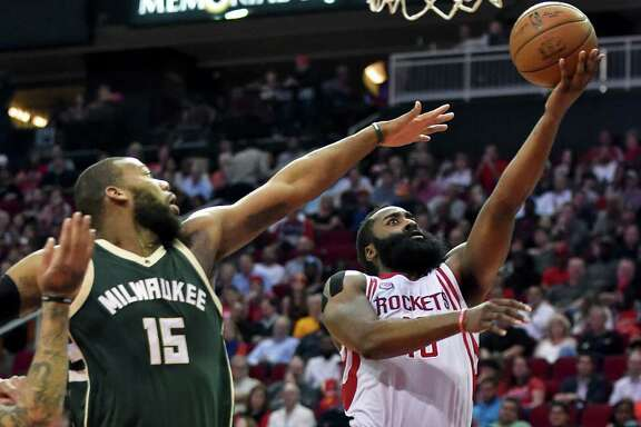 James Harden beats the challenge of the Bucks' Greg Monroe on the way to two of his 38 points.
