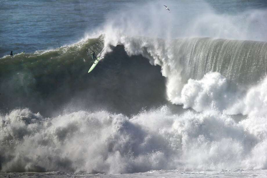 A surfer takes off on a large wave at Maverick's in Half Moon Bay, CA Wednesday, January 7, 2016. Photo: Michael Short / Special To The Chronicle