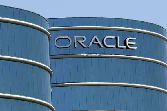 """FILE - This June 18, 2012, file photo shows Oracle headquarters in Redwood City, Calif. The Labor Department is suing Oracle, claiming that the technology giant pays white male workers more than their non-white and female counterparts with the same job titles. In a statement issued Wednesday, Jan. 18, 2017, Oracle  called the lawsuit """"politically motivated, based on false allegations and wholly without merit."""" (AP Photo/Paul Sakuma, File)"""