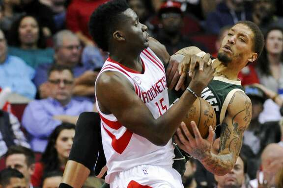 Houston Rockets center Clint Capela, left, and Milwaukee Bucks forward Michael Beasley vie for possession of the ball during the second half of an NBA basketball game, Wednesday, Jan. 18, 2017, in Houston. Houston won 111-92. (AP Photo/Eric Christian Smith)