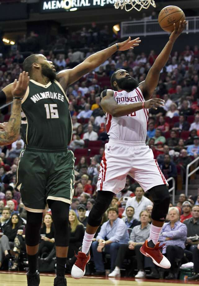 Houston Rockets guard James Harden, right, drives past Milwaukee Bucks center Greg Monroe (15) during the second half of an NBA basketball game, Wednesday, Jan. 18, 2017, in Houston. Houston won 111-92. (AP Photo/Eric Christian Smith) Photo: Eric Christian Smith/Associated Press