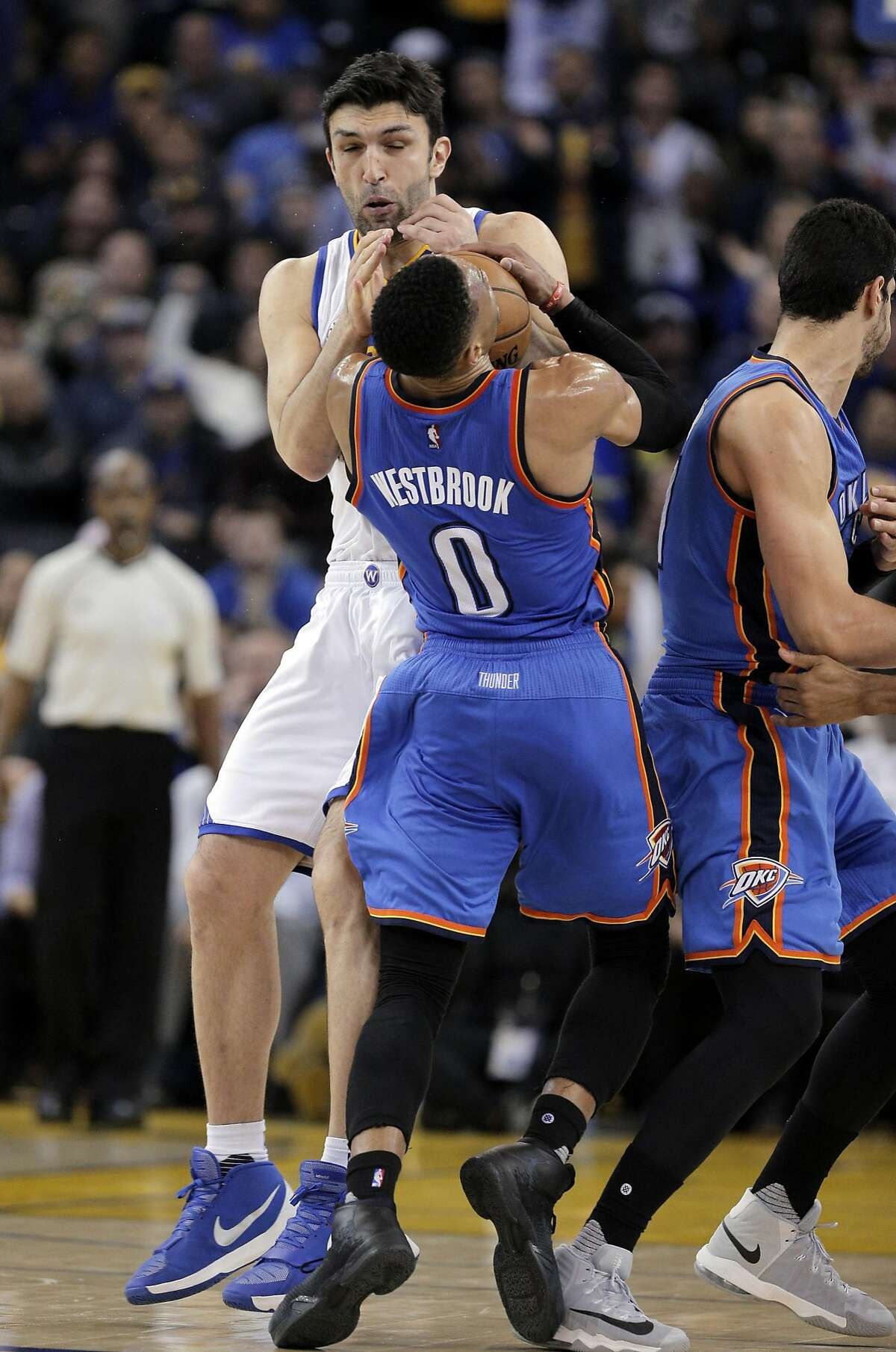 Russell Westbrook (0) collides with Zaza Pachulia (27) which was assessed a flagrant 1 against Pachulia as the Golden State Warriors played the Oklahoma City Thunder at Oracle Arena in Oakland, Calif., on Wednesday, January 18, 2017.