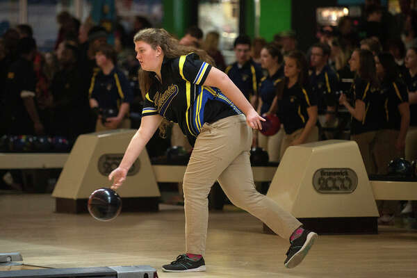 BRITTNEY LOHMILLER | blohmiller@mdn.net Midland High's Haley Russell warms up before the start of the Saginaw Valley League bowling meet Wednesday evening at Northern Lanes.