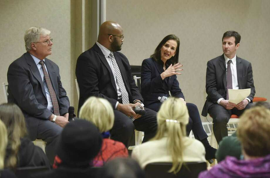 """District of Connecticut U.S. Attorney Deirdre Daly speaks beside Greenwich Public School Interim Superintendent Dr. Sal Corda, left, Boys & Girls Club of Greenwich CEO Bobby Walker Jr., second from left, and moderator Anti-Defamation League Connecticut Regional Director Steve Ginsburg during the """"Why Words Still Matter"""" panel discussion at the YWCA in Greenwich, Conn. Wednesday, Jan. 18, 2017. To honor the legacy of the Rev. Dr. Martin Luther King Jr., panelists discussed the rise of hate speech and hate crimes, as well as the role of citizens and community organizations standing together against hate. District of Connecticut U.S. Attorney Deirdre Daly, Boys & Girls Club of Greenwich CEO Bobby Walker Jr., and Greenwich Public School Interim Superintendent Dr. Sal Corda spoke on the issues, moderated by Anti-Defamation League Connecticut Regional Director Steve Ginsburg. Photo: Tyler Sizemore / Hearst Connecticut Media / Greenwich Time"""