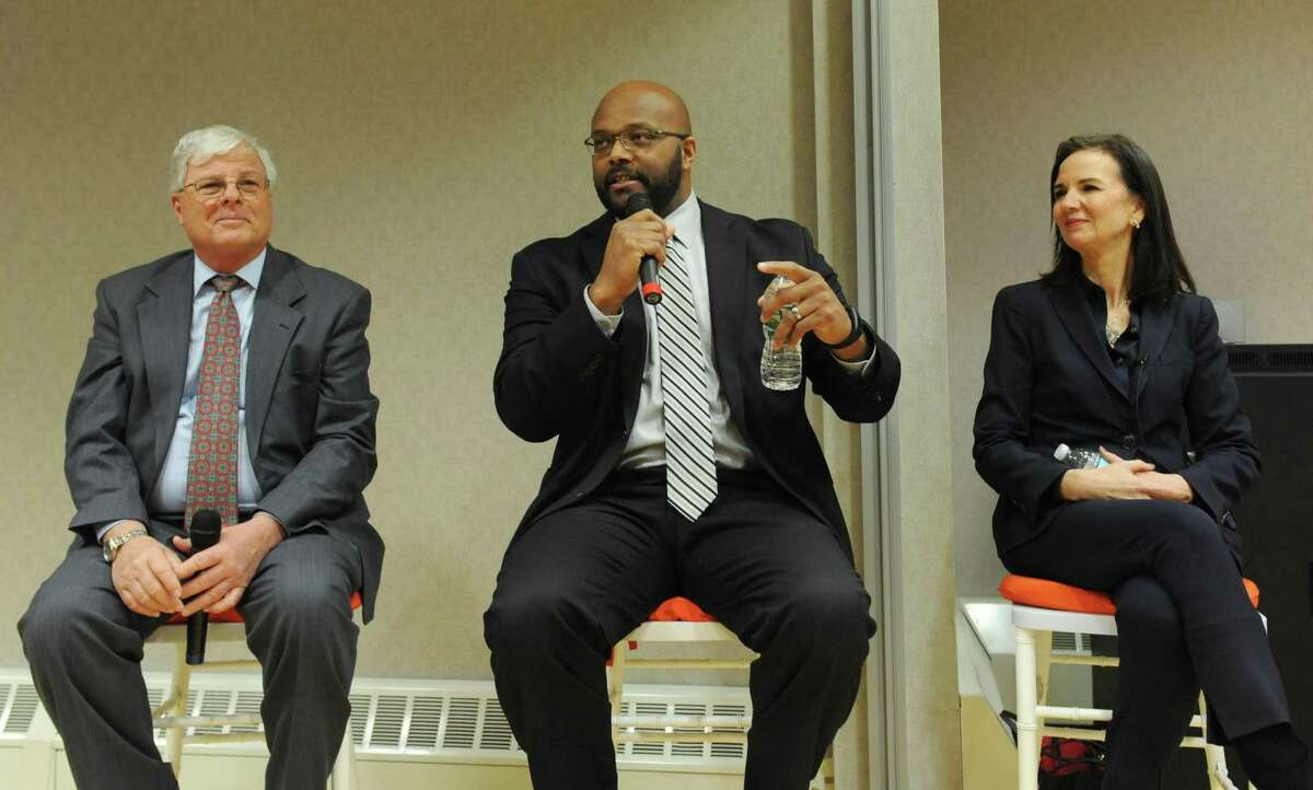 """Bobby Walker Jr., center, CEO of the Boys & Girls Club of Greenwich speaks during a forum called """"Why Words Still Matter,"""" at the YWCA in Greenwich on Wednesday. With him are Sal Corda, interim superintendent of schools in Greenwich, and Deirdre Daly, U.S. attorney for Connecticut. fellow speakers hate crimes beside Greenwich Public School Interim Superintendent Dr. Sal Corda and District of Connecticut U.S. Attorney Deirdre Daly during the """""""" panel discussion at the YWCA in Greenwich, Conn. Wednesday, Jan. 18, 2017. To honor the legacy of the Rev. Dr. Martin Luther King Jr., panelists discussed the rise of hate speech and hate crimes, as well as the role of citizens and community organizations standing together against hate. District of Connecticut U.S. Attorney Deirdre Daly, Boys & Girls Club of Greenwich CEO Bobby Walker Jr., and Greenwich Public School Interim Superintendent Dr. Sal Corda spoke on the issues, moderated by Anti-Defamation League Connecticut Regional Director Steve Ginsburg."""