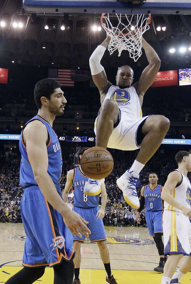 Golden State Warriors' David West (3) dunks next to Oklahoma City Thunder's Enes Kanter, left, during the first half of an NBA basketball game Wednesday, Jan. 18, 2017, in Oakland, Calif. (AP Photo/Marcio Jose Sanchez) Photo: Marcio Jose Sanchez, Associated Press