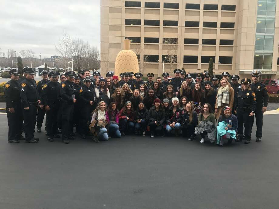 San Antonio police officers pose with TDEA dance students in Washington D.C. The San Antonio Police Department sent 45 officers to Washington D.C. Wednesday morning to help with security during Inauguration Day. The dancers will perform at the Texas Society Boots and Black-Tie Gala on Wednesday, Jan. 19, 2017. Photo: Courtesy