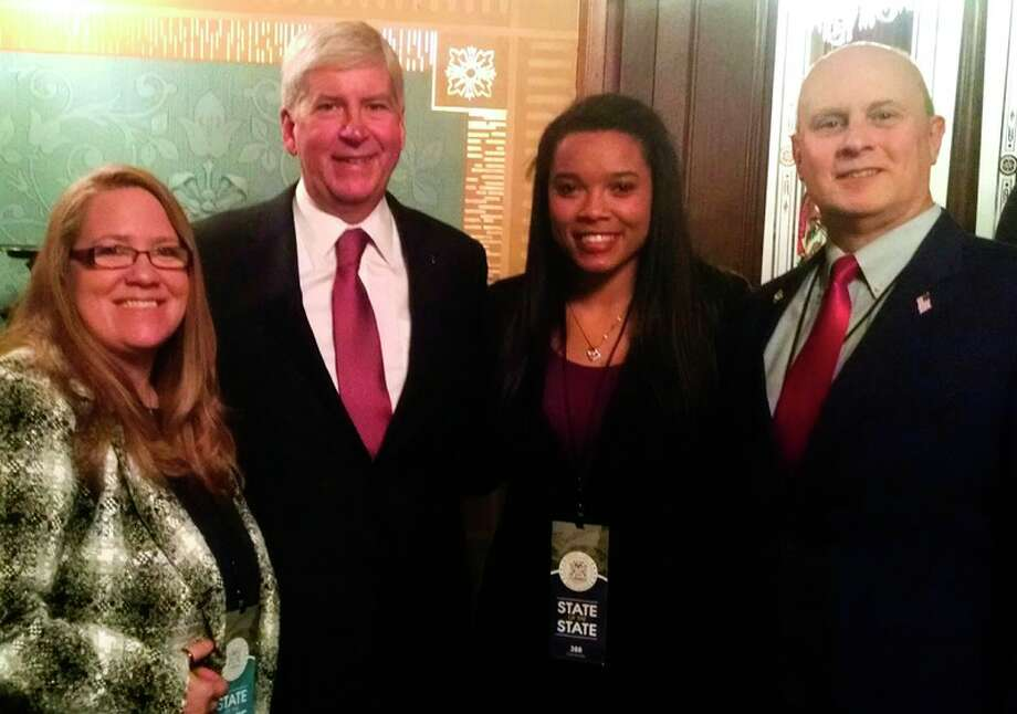 April Brooks, Gov. Rick Snyder, Ashton Brooks and Rep. Gary Glenn