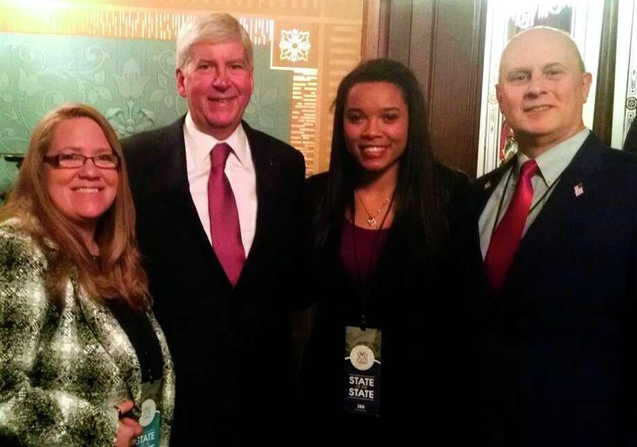 April Brooks, Gov. Rick Snyder, Ashton Brooks and Rep. Gary Glenn