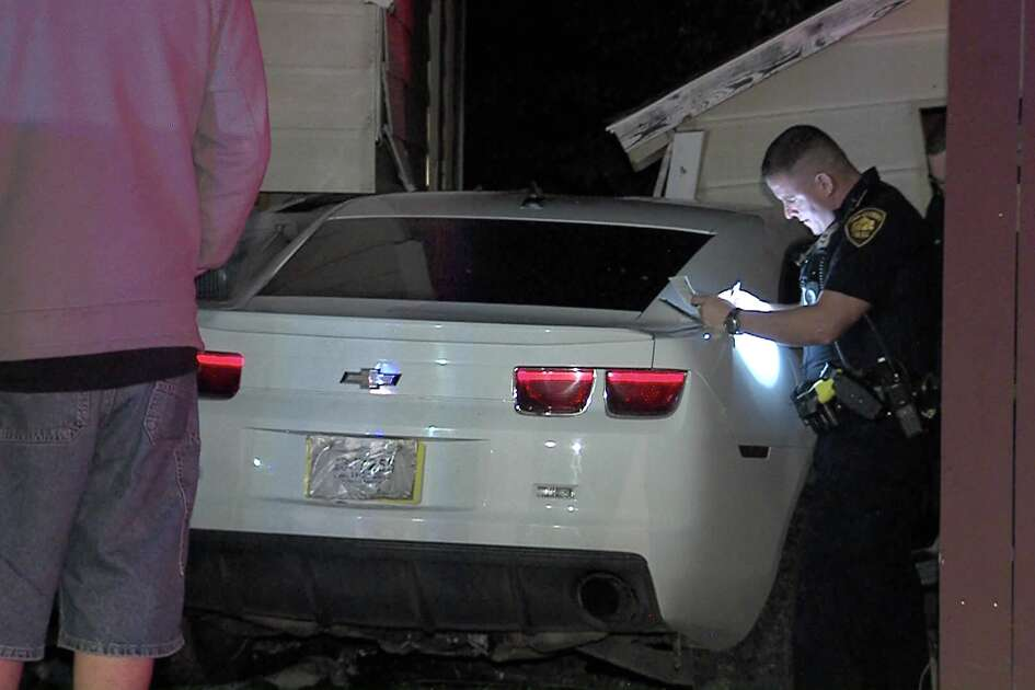 A white Camaro plowed into a utility box before crashing into a home in the 6600 block of Rosewood Crest on Jan. 18, 2017.