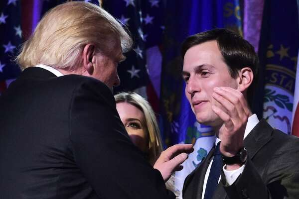 Republican presidential nominee Donald Trump shakes hands with son-in-law Jared Kushner.
