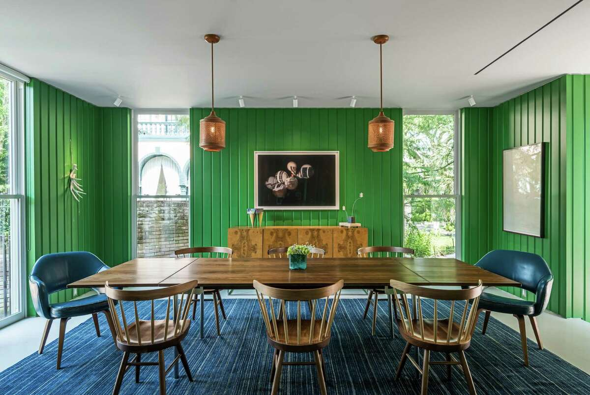 The dining room serves as a gallery for a rotating collection of contemporary and modern art.