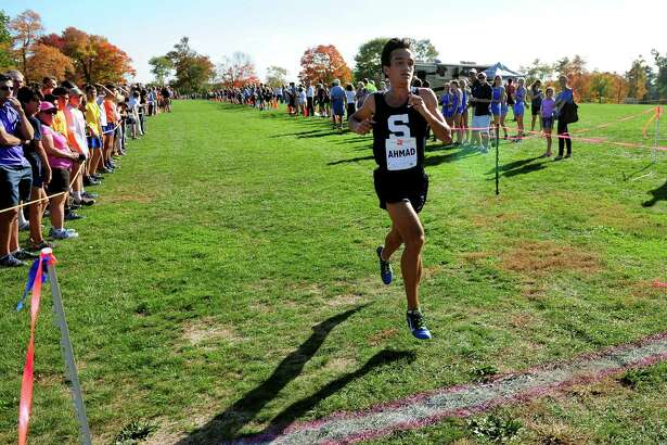 Staples' Zakeer Ahmad crosses the finish line in the FCIAC boys cross country championship at Wavenly Park in New Canaan on Oct. 19.