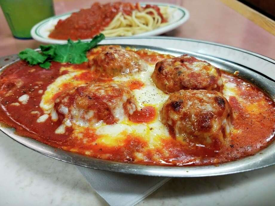 Photo by MAtthew Woods The meatball casserole at Grampa Tony's restaurant, 1108 Columbus Ave. in Bay City, came loaded with over-sized meatballs and mozzarella cheese ( I passed on the mushrooms), a side of spaghetti, salad, and a basket loaded to the top with sliced bread, breadsticks and garlic bread, along with plenty of butter.
