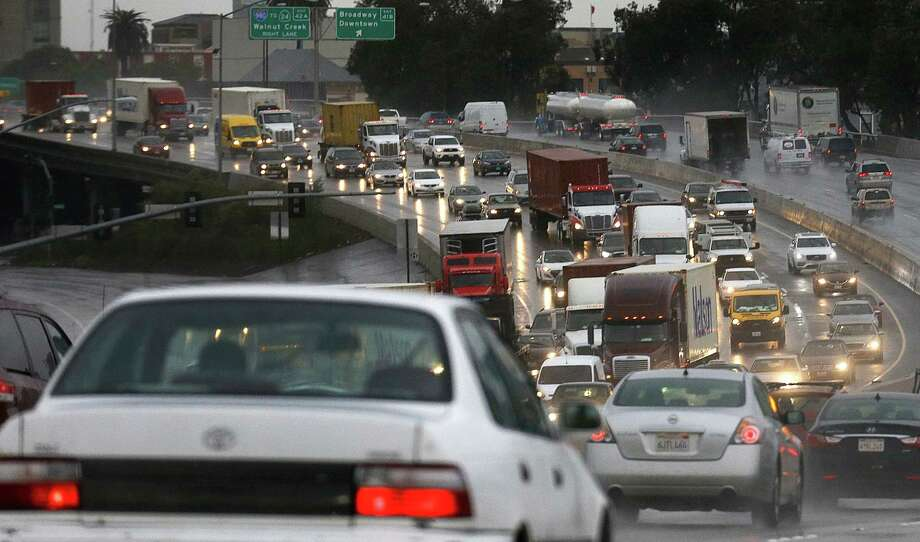 Heavy traffic is seen along Interstate 880 during a rain storm on Wednesday, Jan. 18, 2017, in Oakland, Calif. The San Francisco Bay Area is being hit with a new series of rain storms. Photo: Ben Margot, AP / Copyright 2017 The Associated Press. All rights reserved.