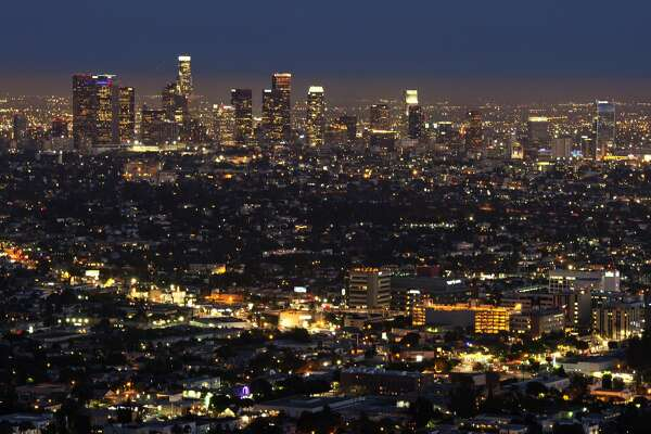 The Los Angeles skyline is seen during twilight on August 21, 2013 in California.    AFP PHOTO /JOE KLAMAR        (Photo credit should read JOE KLAMAR/AFP/Getty Images)