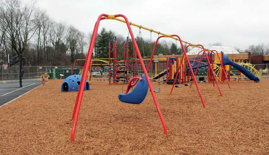 The new playground behind Miller-Driscoll features a musical station, swings, slides, and plenty of other structures to climb and a basketball court nearby. Photo: Stephanie Kim / Hearst Connecticut Media