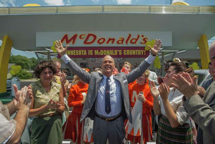 "Michael Keaton (center) portrays Ray Kroc in ""The Founder,"" which is about the formation of the McDonald's franchise."