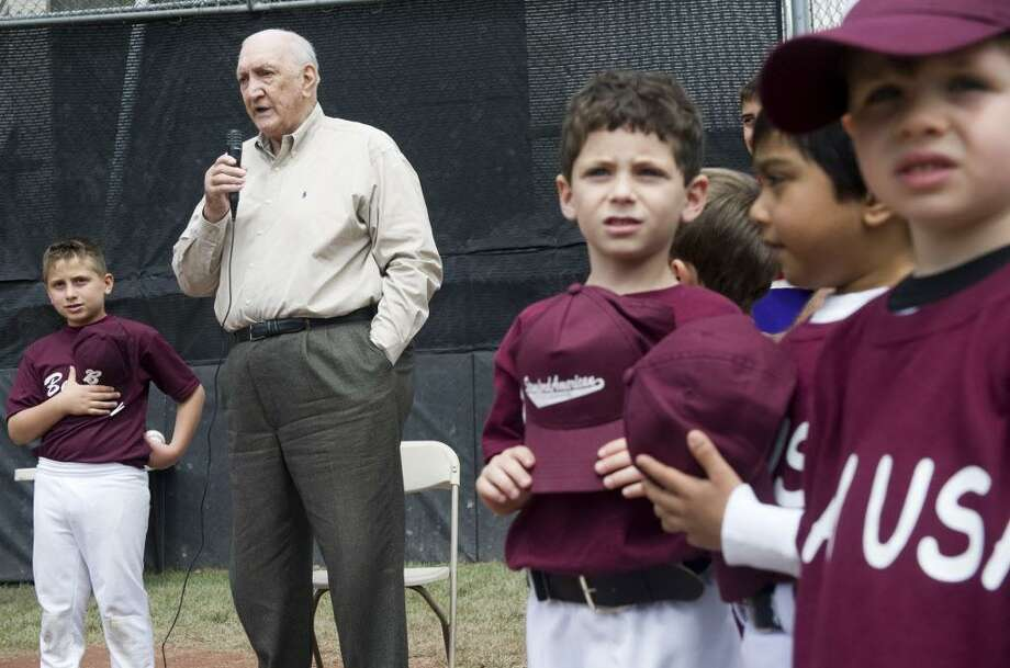 """Former Brooklyn Dodgers pitcher Ralph Branca performs the National Anthem before throwing out the first pitch at the Stamford American Little League's season kickoff at Gene Caporizzo Field in Stamford, Conn., May 6, 2012.  Branca threw the pitch that resulted in New York Giant Bobby Thomson's """"Shot Heard Round the World"""" pitch in 1951. Photo: Keelin Daly / Keelin Daly / Stamford Advocate"""