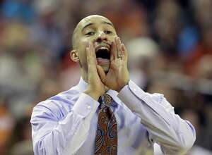 Texas head coach Shaka Smart calls to his players during the first half of an NCAA college basketball game against West Virginia, Saturday, Jan. 14, 2017, in Austin, Texas. (AP Photo/Eric Gay)
