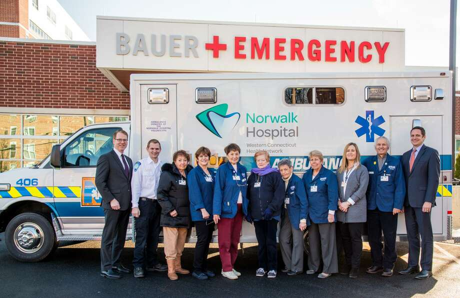 Pictured on Dec. 20, 2016 are (from left):  Seamus Collins, Vice President, Development, Norwalk Hospital Foundation; Matt Soicher, Director, Emergency Medical Services, Norwalk Hospital; Rosaria Vento, gift shop volunteer; Susan Goldstein, gift shop volunteer; Fran Romano, Norwalk Hospital Volunteers Board Secretary; Margaret Laux, gift shop volunteer; Martha Rosenfeld, volunteer; Ellen Mulhearn, Norwalk Hospital Volunteers Board Assistant Treasurer; Karen Tricarico, Norwalk Hospital Volunteers Board Vice President; Corky Stewart, Norwalk Hospital Volunteers Board President and Mike Daglio, President, Norwalk Hospital. Photo: Contributed Photo / Contributed / 2016