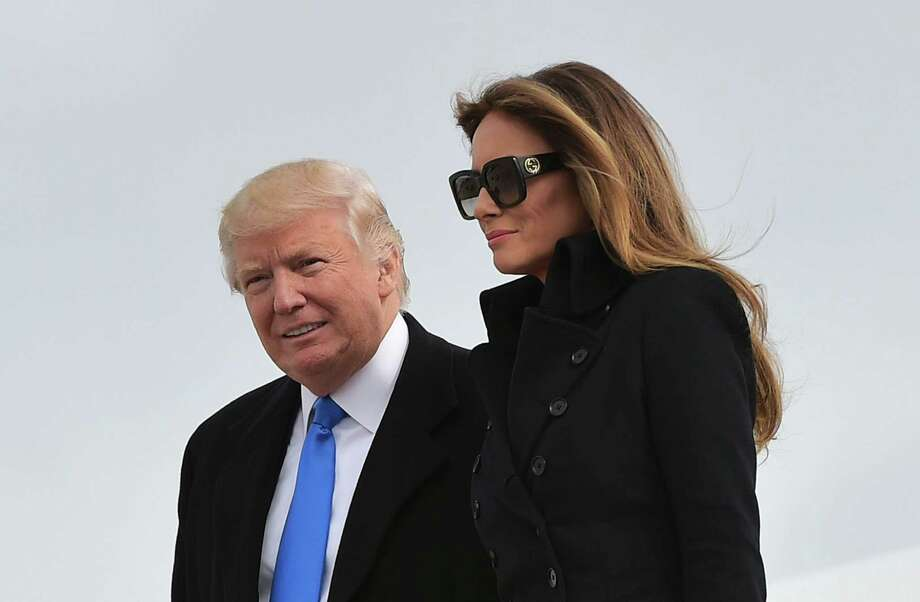 President-elect Donald Trump and his wife, Melania, step off a plane upon arrival at Andrews AFB in Maryland the day before his inauguration as president. Russian magnates and American investors alike are anticipating a Trump administration that removes punishing sanctions, frees up access to capital and encourages U.S. businesses pursuing profits in Russia's vast market — regardless of Russian President Vladimir Putin's policies. Photo: Mandel Ngan /AFP /Getty Images / AFP or licensors