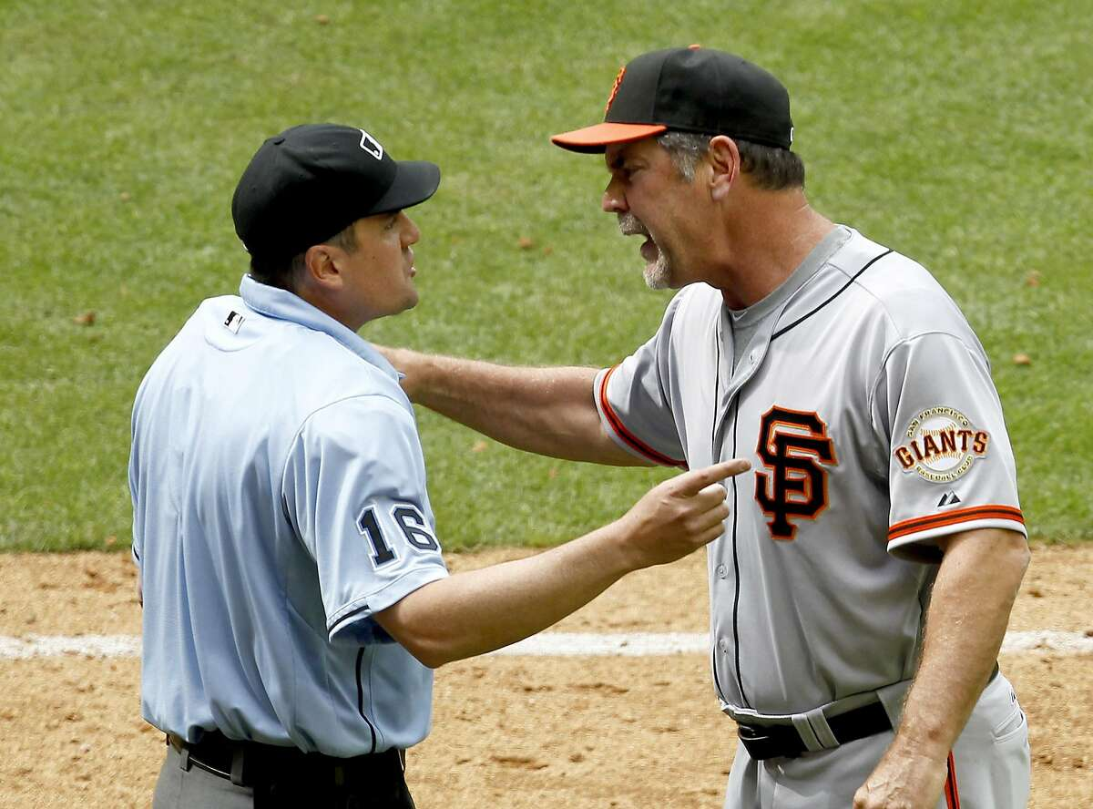 San Francisco Giants manager Bruce Bochy, right, argues with home plate umpire Mike DiMuro after being tossed from the game during the seventh inning in an MLB baseball game against the Arizona Diamondbacks Sunday, April 8, 2012, in Phoenix.(AP Photo/Ross D. Franklin)