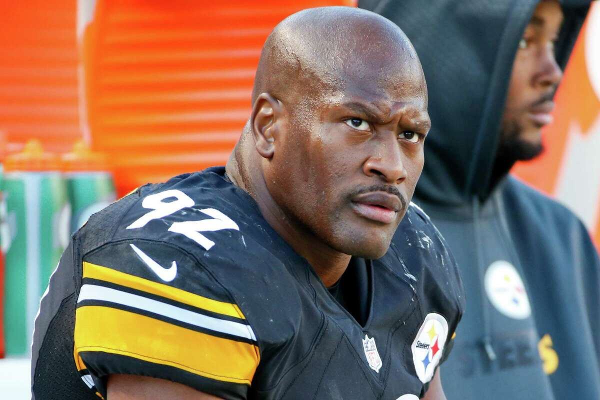 FILE - In this Nov. 8, 2015, file photo, Pittsburgh Steelers outside linebacker James Harrison sits on the sidelines during an NFL football game against the Oakland Raiders in Pittsburgh. Harrison was the top vote getter in Tampa Bay Times writer Greg Auman's most badass player poll of NFL writers.