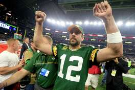 Green Bay Packers quarterback Aaron Rodgers (12) celebrates after winning an NFL divisional playoff football game against the Dallas Cowboys Sunday, Jan. 15, 2017, in Arlington, Texas. The Packers won 34-31. (AP Photo/Ron Jenkins)