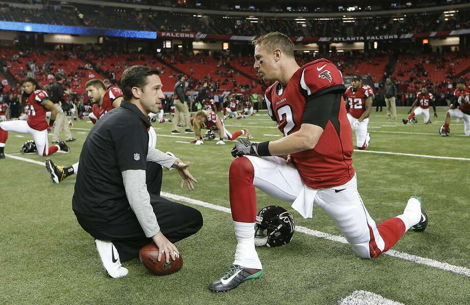 Faclons offensive coordinator Kyle Shanahan and quarterback Matt Ryan. Photo: John Bazemore, Associated Press